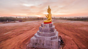 Red sky over buddha statues Stock Photo