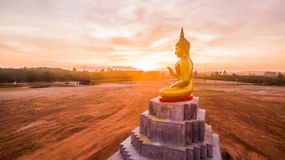 Red sky over buddha statues Royalty Free Stock Photo