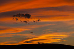 Red sky over hill in summer Royalty Free Stock Photos
