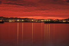 Red Sky, Red Bay, & Lights Royalty Free Stock Image