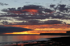 Red Sky Reflections. Sunset @ Birling Gap, Nr Eastbourne, East Sussex royalty free stock image