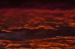 Red sky. The storm sky with various shades of red color, with dark clouds Stock Photo