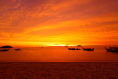 Red sky on Sunrise beach on sunrise,Lipe island,Thailand Royalty Free Stock Photography