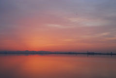 Red sky before sunrise at dawn at Tunis lake Stock Photography