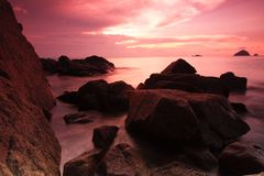 Red sky sunrise at Perhentian Island beach Stock Photo