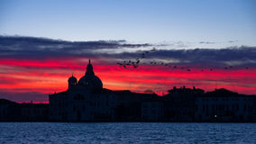 Red sky at sunrise in Venice near Grand Canal Royalty Free Stock Image