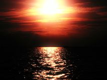 Red sky. While sunset at the sea Stock Photo