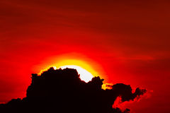 Red sky white sun and black cloud Royalty Free Stock Image