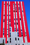 Red skyscraper and blue sky, Spain. Red skyscraper and blue sky Stock Photography