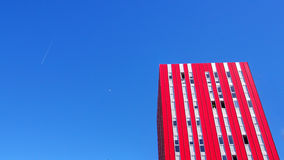 Red skyscraper and moon Valencia. Red skyscraper and moon y sky Stock Images