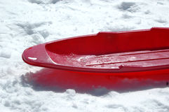 Red sled. A red sled on white snow Royalty Free Stock Photo