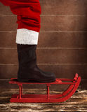 Red sled with the boot of Santa Claus Royalty Free Stock Photography