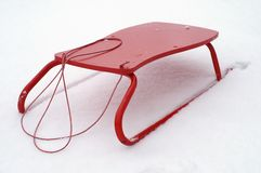 Red sledge. In the fresh snow Stock Photography