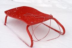 Red sledge. In the fresh snow Stock Images