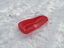 Red sledge in the snow stock photography