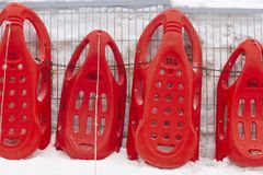 Red sledges ready to rent. Winter sports. Recreation. Horizontal Royalty Free Stock Image