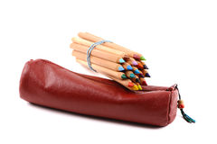 Red sleeve with color pencils Royalty Free Stock Photos