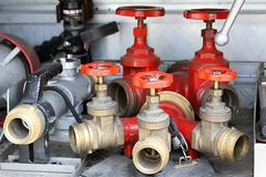 Red Sleeve valves and fire lances of trucks of firefighters duri Royalty Free Stock Photos