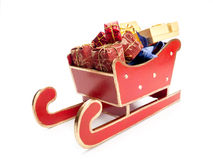 Red sleigh with christmas presents Royalty Free Stock Photography