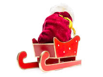 Red sleigh with Santa's sack Royalty Free Stock Images