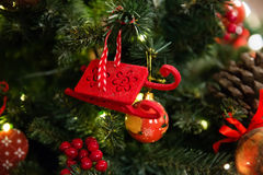 Red sleigh toy on Christmas tree Royalty Free Stock Image