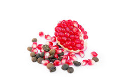 Red sliced pomegranate with coffee and pomegranate grains Stock Photo