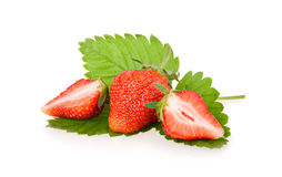Red sliced strawberry fruits with green leaves Stock Photo