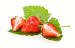 Red sliced strawberry fruits with green leaves Royalty Free Stock Photos