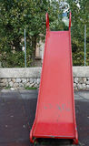 Red slide. View of a red slide in a park stock photos