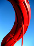 Red Slide. A red slide contrasts the blue sky Royalty Free Stock Image