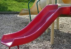 Red slide. Red playground slide Stock Images