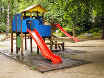 Red slides in a playground for children Royalty Free Stock Image