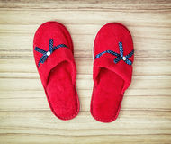 Red slippers with blue ribbon on the wooden background, retro st Royalty Free Stock Photos