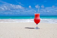 Red Slush Drink in Glass on Beach Royalty Free Stock Photography