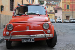 Red small car in the streets of Florence Stock Image
