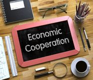 Small Chalkboard with Economic Cooperation Concept. 3D. stock photos