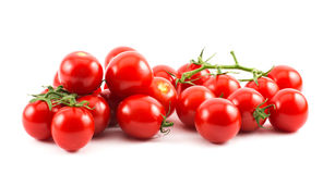Red small cherry tomatoes on a white background.  royalty free stock image