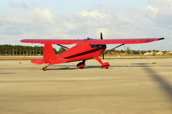 Red Small Plane. Small red airplane in private airport royalty free stock photo