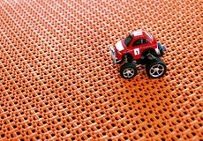 Red small RC Off-road truck car Radio-controlled standing on o Royalty Free Stock Photos
