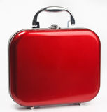Red small suitcase Stock Images