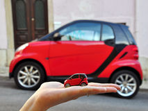 Red smart car: small the smaller Stock Photo