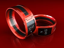 Red Smart Watches. 3d rendering of two red sport-style smart watches over a reflective surface Royalty Free Stock Images