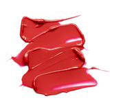 Red smear paint of cosmetic products Royalty Free Stock Image