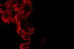 Red smoke on black background Stock Photos