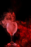 Red smoke in the glass. Halloween. Stock Images