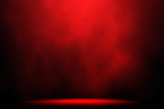 Red smoke spotlight stage background.