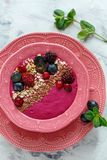 Red smoothie bowl with beets, blackberries and brown flax. Stock Photo