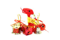 The red snake symbol of new year, among the toys. The red snake among the new years small toys Royalty Free Stock Image