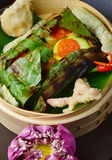 Red snapper fish fillet wraped in banana leaf Royalty Free Stock Images