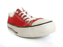Red sneaker. Close-up of a classic red sneaker isolated on white Royalty Free Stock Photography